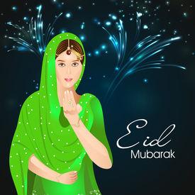 foto of ramazan mubarak  - Beautiful muslim young woman saying salam in fireworks night for the celebrations of Muslim community festival Eid Mubarak - JPG