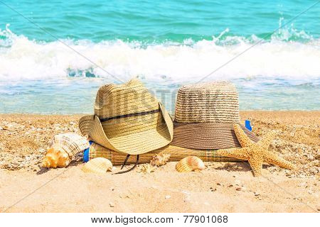 Male And Female Hats On The Beach