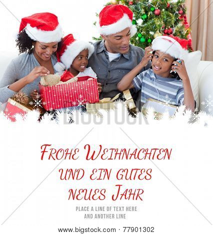 Happy family playing with Christmas presents against frohe weihnachten message