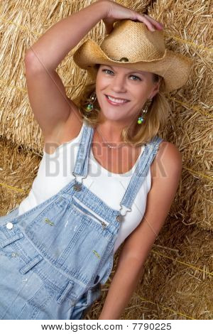 Cowgirl In Hay