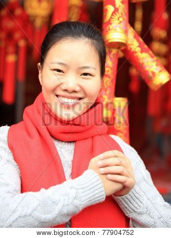 young asian woman hold red chinese knot wishing you a happy chinese new year