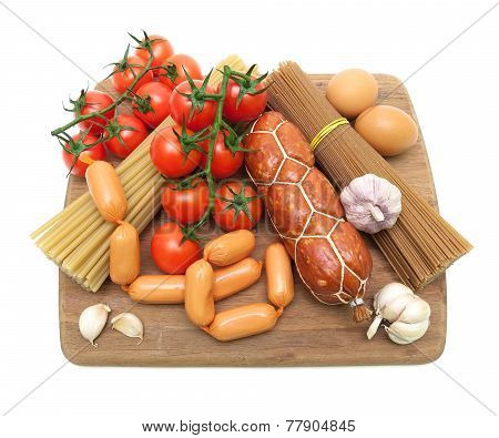 Sausages, Pasta, Eggs And Vegetables Isolated On A White Background