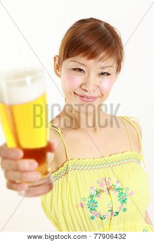 woman with a glass of beer