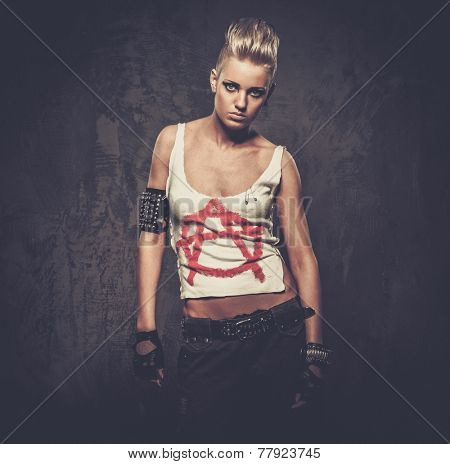 Punk girl with spiked bracelets