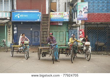 Rickshaws wait for passengers in Puthia Bangladesh.