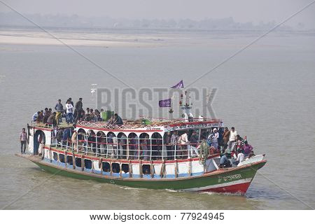 Ferry transport passengers across Ganga river, Bangladesh.