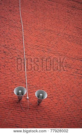 Two Loudspeaker On Brick Wall