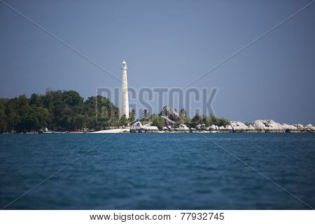 Beautiful white light house and blue sky, sea, with tropical plants