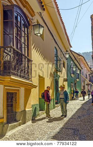 LA PAZ, BOLIVIA, MAY 8, 2014: Tourists at the street Calle Jaen near museums complex