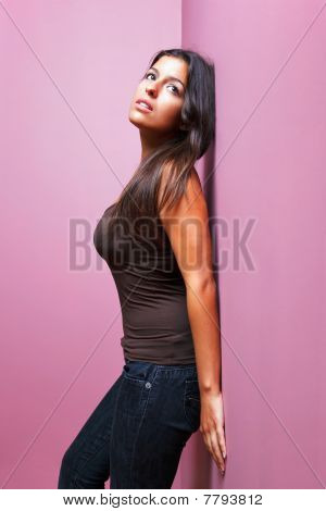 Woman Leaning Against A Wall