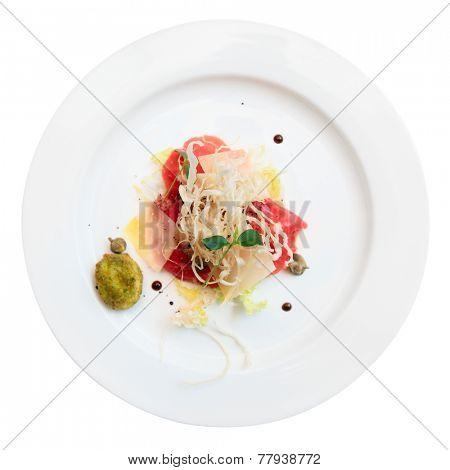 Tuna carpaccio on plate isolated over white background