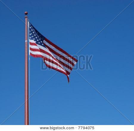 Flag on clear blue sky
