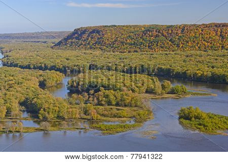 Colorful Bluffs Above A River Confluence In Fall