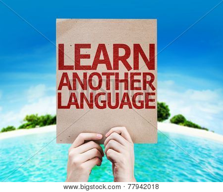 Learn Another Language card with a beach on background