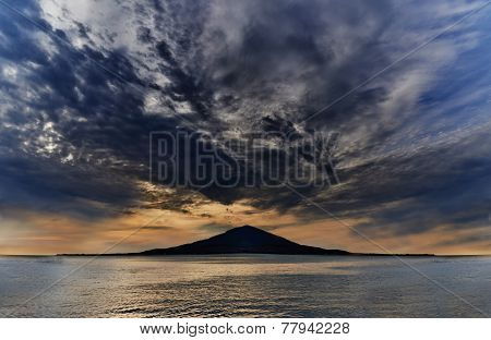 Sunset Over The Island In Blue Ocean