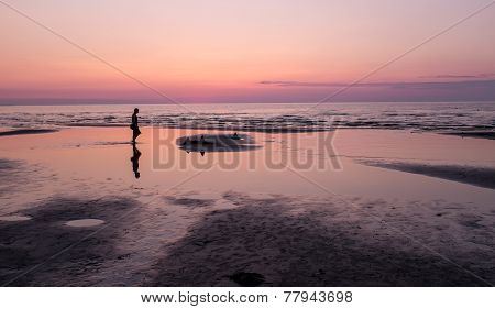 Sunset on the beach and silhouette of man, Jurmala