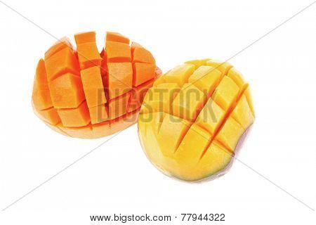 fresh raw carved mango isolated over white background