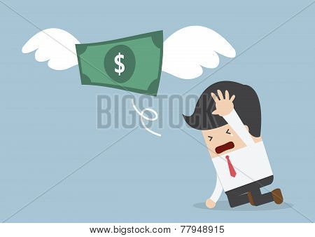 Money Is Flying Away From Sadness Businessman