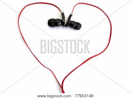 Red Earphone Setting In Heart Shape On White Background