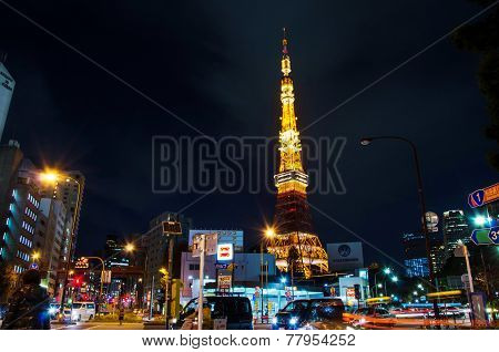 Tokyo, Japan - November 28, 2013: Busy Street At Night With Tokyo Tower