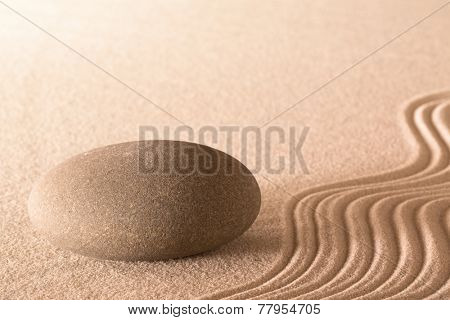 spa massage stone round rock and lines in sand wellness background meditation relaxation and spirituality