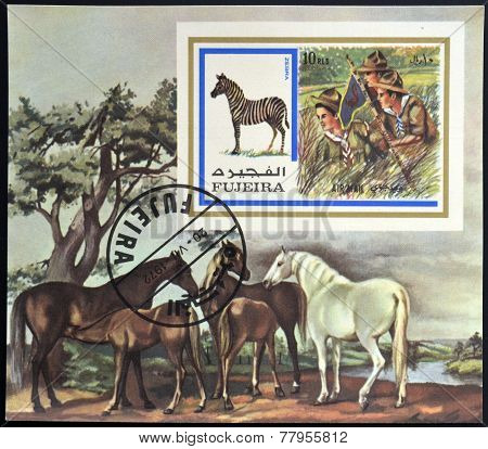 FUJEIRA - CIRCA 1972: A stamp printed in Fujeira shows boy scouts and zebra circa 1972