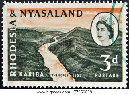 RHODESIA AND NYASALAND - CIRCA 1955: A stamp printed in Rhodesia shows Kariba the gorge