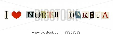 I Love North Dakota formed with magazine letters on a white background