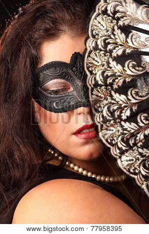 Portrait Of Mysterious Woman With Folding Fan And Mask