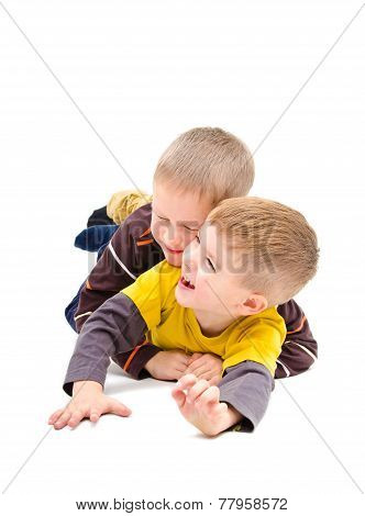 Two boys having fun laughing lying