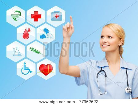 healthcare, medicine, people and symbols concept - smiling young female doctor or nurse with stethoscope pointing finger to medical icons over blue background