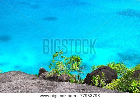 Rocky Landscape In The Seychelles With Sea Water
