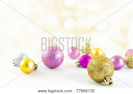 Various Sized And Colored Christmas Balls With Bokeh Background