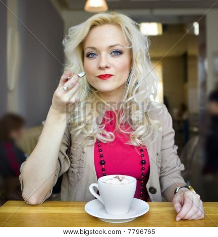 Blonde And White Cup Of Coffee