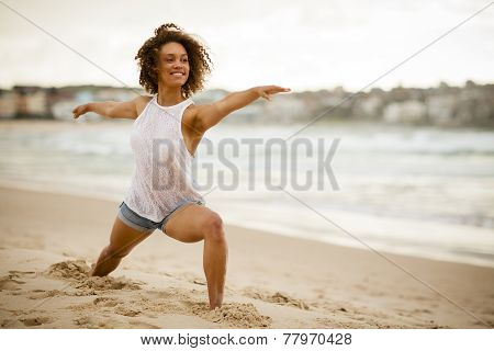 Mixed-race Dancer Stretching On The Beach