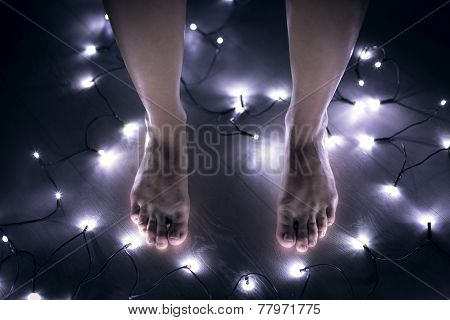 Bare Female Feet Standing On The Floor