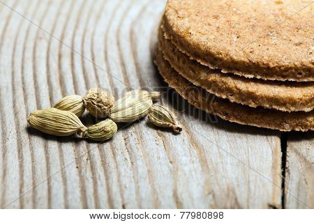 cardamom and cookies on the wooden table