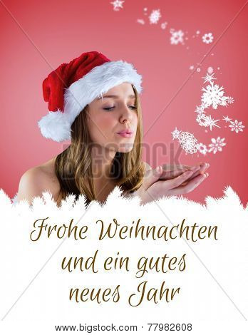 sexy santa girl blowing over hands against christmas greeting in german