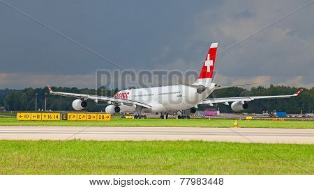 ZURICH - SEPTEMBER 21: Swiss Air A-340 preparing for flight on September 21, 2014 in Zurich, Switzerland. Zurich airport is home port for Swiss Air and one of the biggest european hubs.