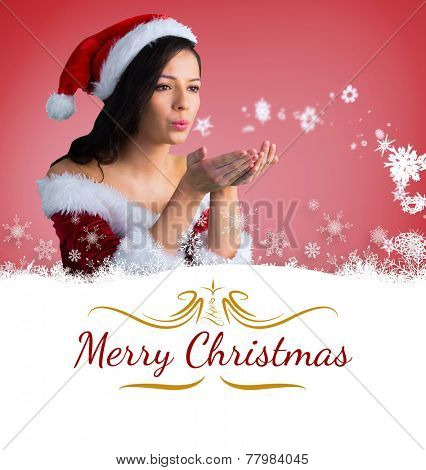 pretty girl in santa outfit blowing against border