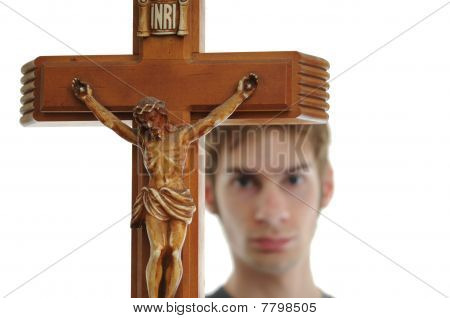 Holding Up Crucifix