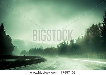 winding mountain road in the fog