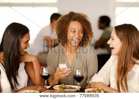Group Of Girls Laughing In A Restaurant