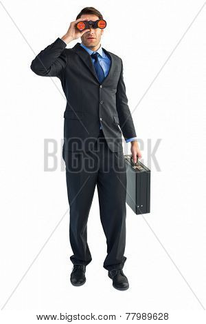 Businessman using binoculars while holding a briefcase on white background