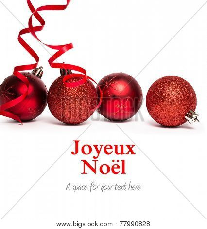 Joyeux noel against four red christmas ball decorations