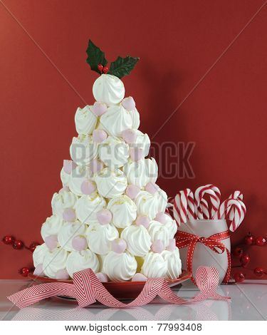 Christmas Tree Dessert Treat Made With Pink And White Meringues With Candy Cane Decorations Against