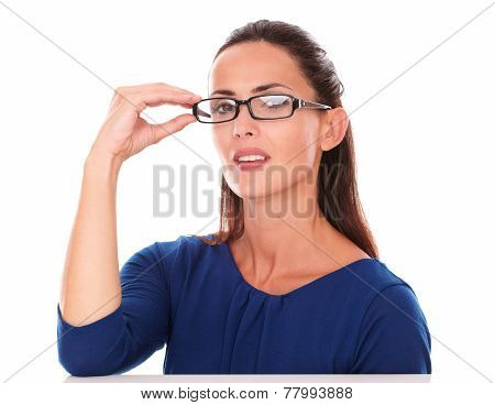 Pretty Lady With Hand On Glasses Looking At You