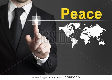 Businessman Pushing Button Peace World
