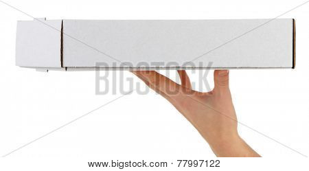 Hand holding cardboard pizza box, isolated on white