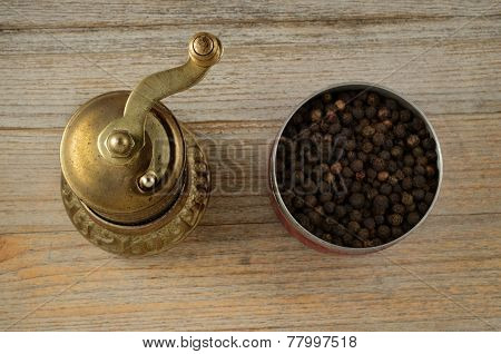 Old Oriental Pepper Mill And Black Pepper Peas